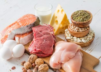 Selection of protein sources in kitchen background, copy space